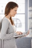 Pretty woman using laptop at home Royalty Free Stock Images