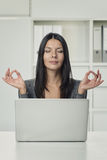 Pretty Woman Using Laptop with Yoga Hand Gestures Royalty Free Stock Photos
