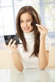 Pretty woman using makeup Royalty Free Stock Photography
