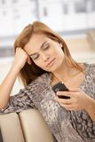 Pretty woman using mobile phone Royalty Free Stock Image