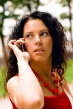 Pretty woman using mobile phone Stock Images