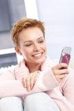 Pretty woman using mobile Stock Photography