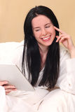 Pretty Woman Using New Technology to Read Stock Photos