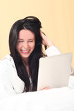 Pretty Woman Using New Technology to Read Stock Photo