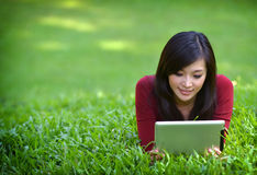 Pretty Woman Using Tablet Stock Image