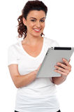 Pretty woman using tablet device Stock Images