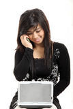 Pretty woman using technology Stock Image
