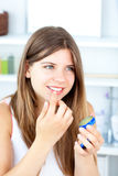 Pretty woman using vaseline for her lips Stock Photography