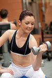 Pretty woman using weights Stock Images