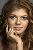 Pretty woman. The very pretty red-haired young woman, sensual captivating look ,vertical portrait stock photos