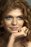 Pretty woman. The very pretty red-haired young woman, sensual captivating look ,vertical portrait stock images
