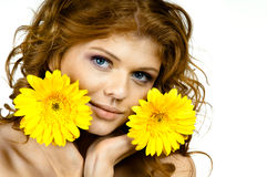 Pretty woman. The very pretty red-haired young woman with yellow flowe, horizontal close up portrait royalty free stock photography
