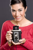 Pretty woman take photo vintage viewfinder camera Stock Images