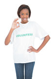 Pretty woman with volunteer tshirt making okay gesture Royalty Free Stock Photography