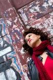 Pretty woman waiting at graffiti wall Stock Images