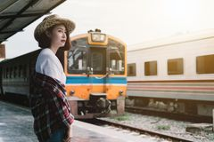 Pretty woman waiting the train at train station for travel in su Stock Images