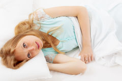Pretty woman waking in  bed Stock Photo