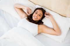 Pretty woman waking up with outstretched arms Stock Image