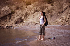 Pretty woman is walking along the beach. tourism Stock Photos