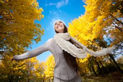 Pretty woman walking in the autumn park Royalty Free Stock Photo