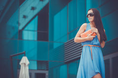 Pretty woman is walking in the city Royalty Free Stock Image