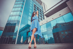 Pretty woman is walking in the city Royalty Free Stock Photography