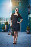 Pretty woman is walking in the city Royalty Free Stock Images