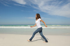 Pretty woman walking exercise beach Stock Photos
