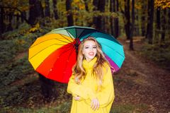 Pretty woman walking in the Park and enjoying the beautiful autumn nature. Beautiful happy smiling girl with long hair. Wearing stylish jacket posing in autumn stock photos
