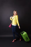 Pretty woman walking with a suitcase Stock Photos