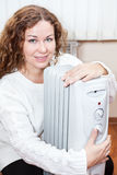 Pretty woman warming with radiator Royalty Free Stock Image