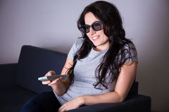 Pretty woman watching movie in 3d glasses at home Stock Photos