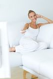 Pretty woman watching television Royalty Free Stock Image