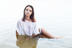Pretty woman in water Royalty Free Stock Photography