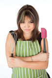 Pretty woman wearing an apron Stock Image