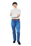 Pretty Woman Wearing Blue Jeans And White Turtleneck Stock Images