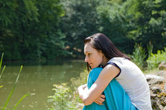 Pretty woman wearing blue skirt posing in nature Stock Image