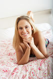 Pretty Woman Wearing Dress Relaxing On Bed Stock Images