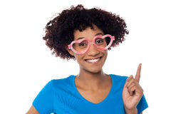 Pretty woman wearing funny heart shaped frame Royalty Free Stock Photo