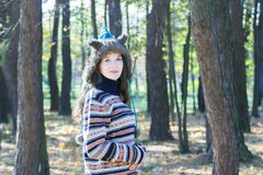 Pretty woman wearing fur animal ears hat and knitted woolly sweater Stock Photos