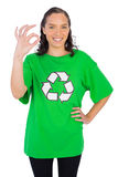 Pretty woman wearing green recycling tshirt showing okay sign Royalty Free Stock Photos