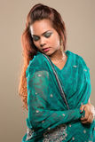 Pretty woman wearing a green sari Stock Image