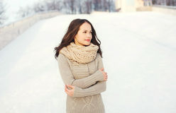 Pretty woman wearing a knitted sweater outdoors in winter Royalty Free Stock Images