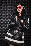 Pretty woman wearing leather jacket Stock Images
