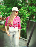 Pretty woman wearing a pink shirt and summer hat Royalty Free Stock Photos