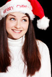 Pretty woman wearing santa hat Stock Photography