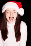 Pretty woman wearing santa hat Royalty Free Stock Images