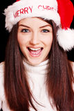 Pretty woman wearing santa hat Stock Image