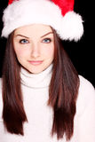 Pretty woman wearing santa hat Stock Photo