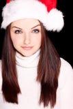Pretty woman wearing santa hat Stock Photo